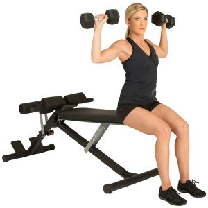 Woman doing dumbbell presses on hyperextension bench 1