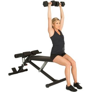 Woman doing dumbbell presses on hyperextension bench 2