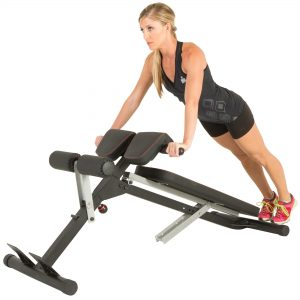 Woman doing platform push up on hyperextension bench