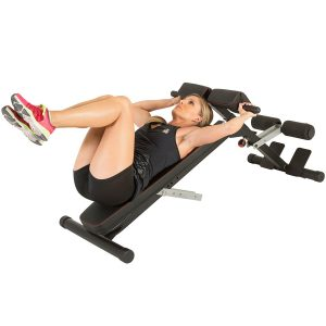 Woman doing knee raises on hyperextension bench 2