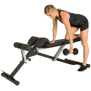 Woman doing dumbbell rows on hyperextension bench