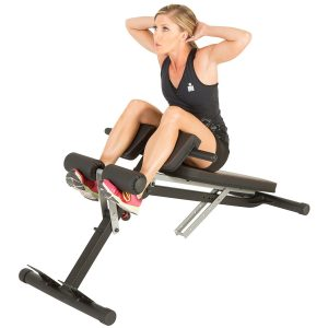 Woman doing incline crunch on hyperextension bench
