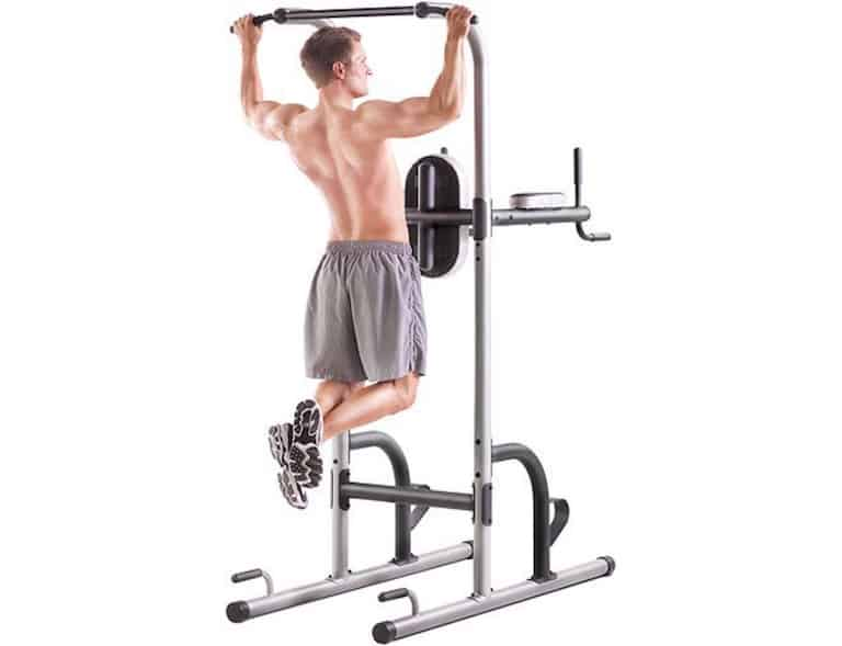 Gold's Gym Xr10.9 power Tower with man doing pull up