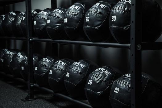 Rack of black 20 lbs rogue med balls