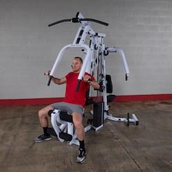 The strengthtech exm2500s home gym has a press station and pec dec station