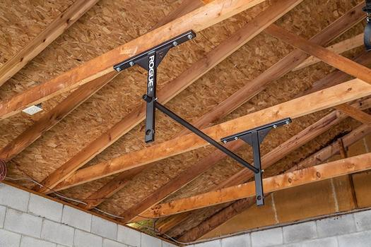 All p series pull up bars from rogue can be mounted on the ceiling if you wish