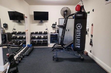 The rubber flooring tiles will make your home gym look great