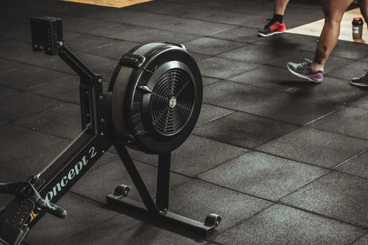 Rowing machines provide an intense low-impact cardio workout