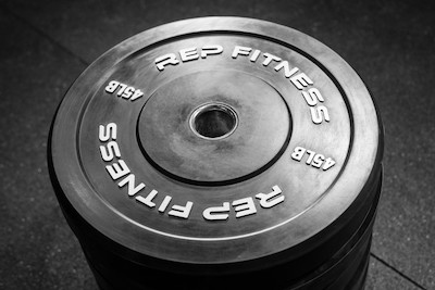 Rep Fitness' black bumpers are the best value bumper plates on the market