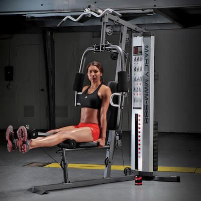 Woman doing leg extensions in a Marcy 150 lb stack home gym