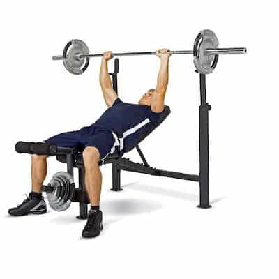 Man doing bench press in Marcy Olympic Weight Bench