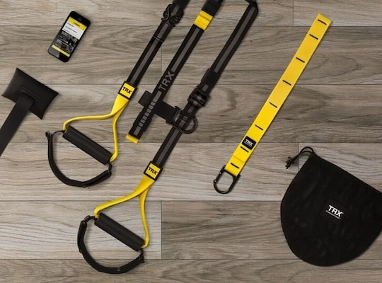 TRX all-in-one suspension trainer on laminate floor with carry case