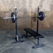 Fringe Sport indy squat stands with loaded barbell and weight bench