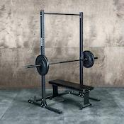 Fringe Sport garage series budget squat rack with loaded barbell and weight bench