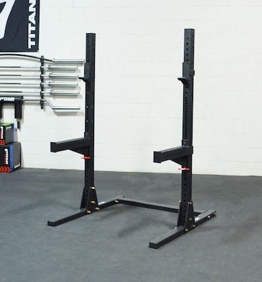 Black titan fitness squat rack with spotter arms