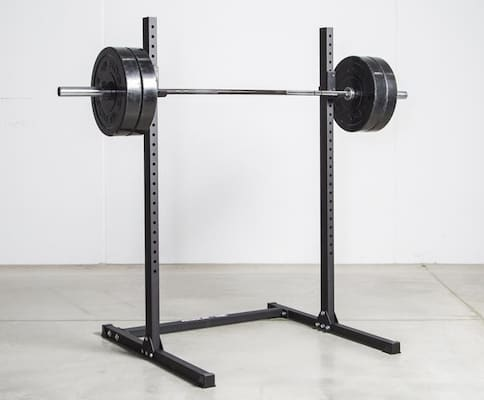 Rogue's budget echo squat stand with loaded barbell