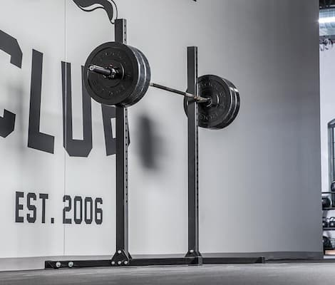 Rogue Fitness Echo squat stand with loaded barbell on j cups