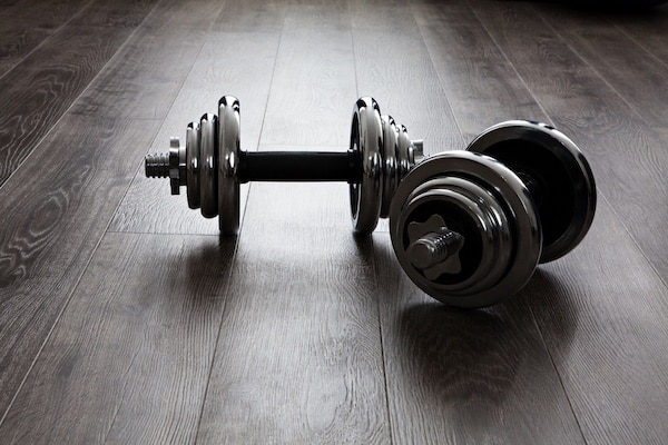 Dumbbells are some of the best exercise equipment for apartments and small spaces
