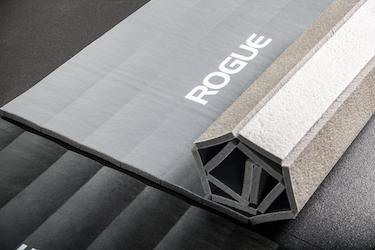 The Rogue Individual Mat has 2 inch slit in the padding to allow it to roll up easily
