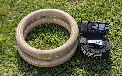 Rep Fitness wooden gymnastic rings on grass
