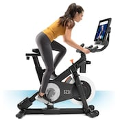 Side on view of NordicTrack studio cycle spin bike