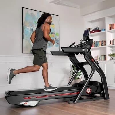 Man running on Bowflex Treadmill 10
