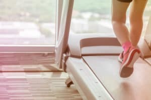 Woman wear pink go workout by running using treadmill