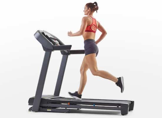 Fit woman running on horizon t101 treadmill