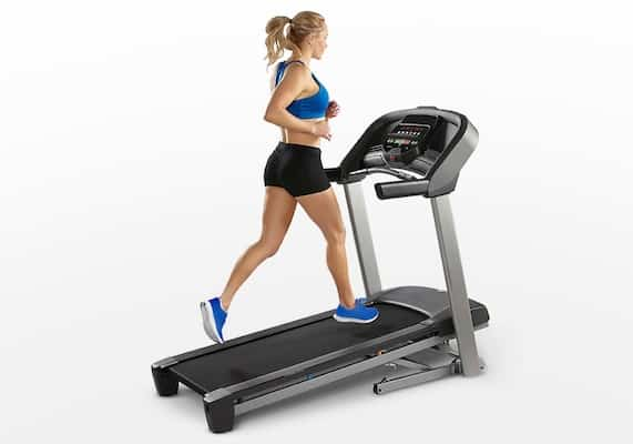 Fit woman running on Horizon T101 Treadmill