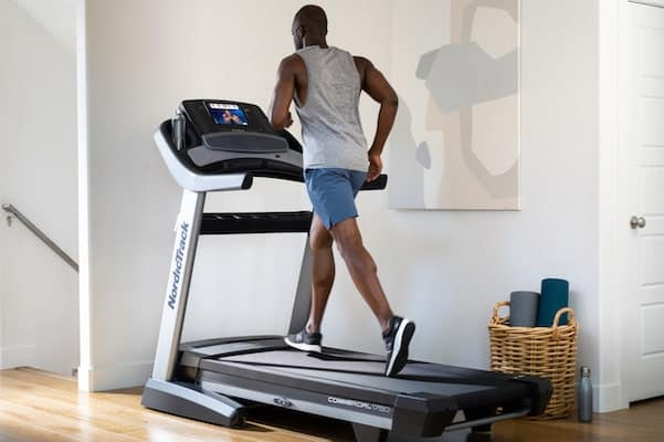 Fit man running on commercial 1750 treadmill