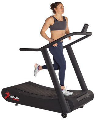 Woman running on TrueForm Runner manual treadmill