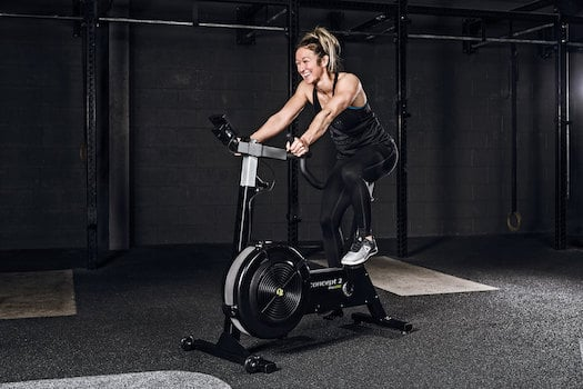Laughing woman on concept2 bikeerg
