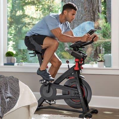 Man riding bowflex c6 home spin bike