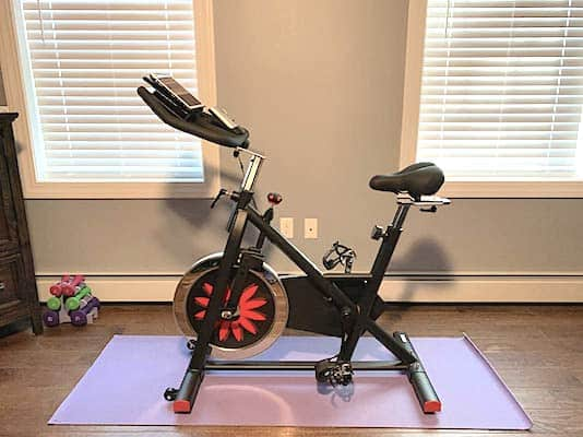 Joroto X2 home spinning bike sitting in a home gym