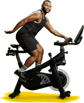 Man riding the soulcycle at home spinning bike
