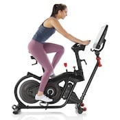 Woman riding a bowflex velocore home spinning bike
