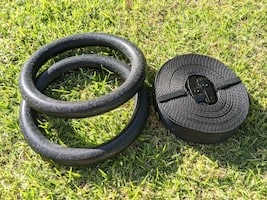 GarageFit gymnastic rings sitting on green grass