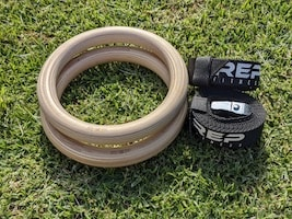 Rep Fitness wood gymnastic rings on grass