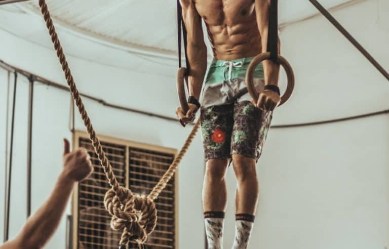 Man doing support hold showing gymnastic rings benefits