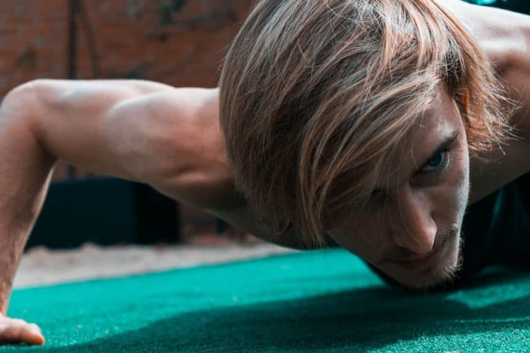 Man doing push-ups with intense look on his face