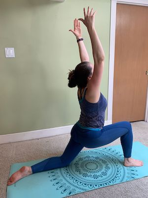 Author doing crescent lunge yoga stretch to improve flexibility