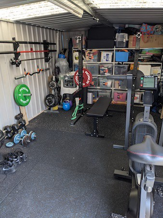 Actual home gym in a backyard shed