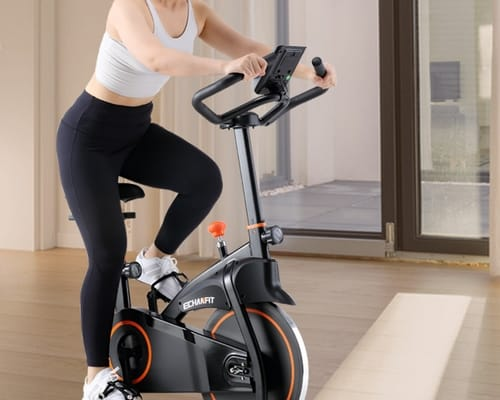 Woman on echanfit 2901 folding indoor exercise bike
