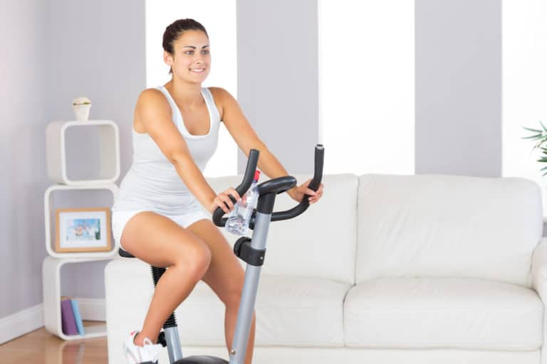Fit woman training on one of the best budget exercise bikes