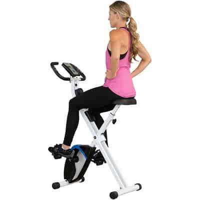 Woman on progear 225 folding magnetic exercise bike