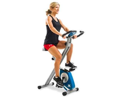 Woman on xterra fitness fb150 folding exercise bike