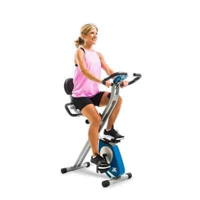 Woman on next xterra fitness fb350 folding exercise bike