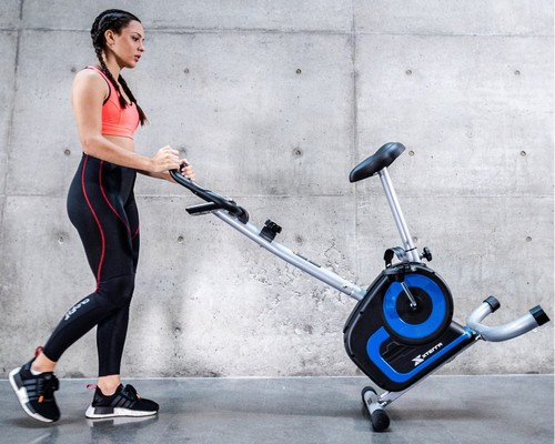 Woman pushing xterra fitness ub120 upright bike