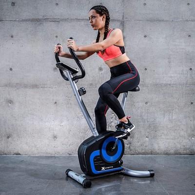 Woman on xterra fitness ub120 upright bike