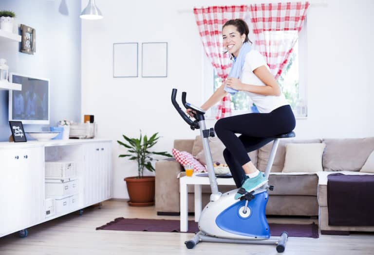 Fit woman training on one of the best budget exercise bikes under $500